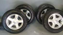 Isuzu 17'' original mags with new 255/65/17 goodyear all terrain tyres