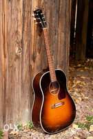A fairly used acoustic guitar for sale at affordable price