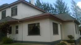 2 br furnished guest house to let in muthaiga north for 100k