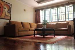 NINE-Seater brown L-shape couch