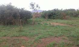 Half an acre opposite roofings Entebe road at 550m