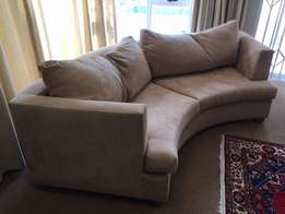 curved couch in excellent condition