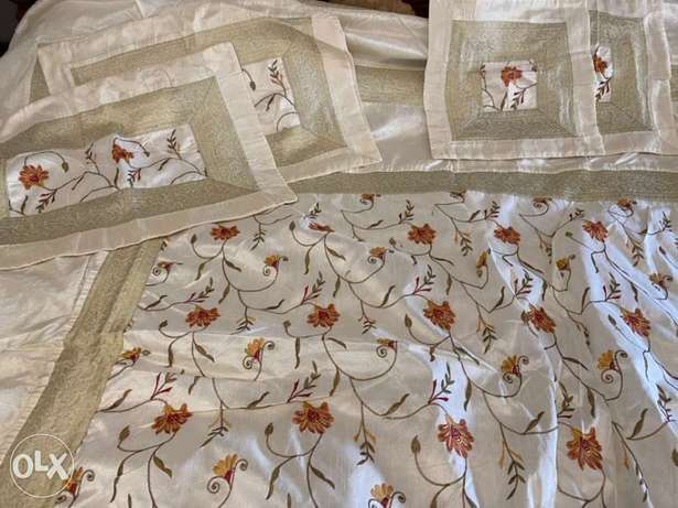 beautiful gold and beige bed cover