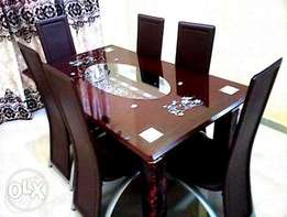 Six Glass Dining Set with leather Chairs