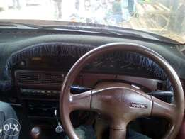 Toyota corolla old shape, colour, white, year 1992,mileages, 358200