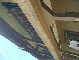 Decent 2bedroom flat at ikotun filling isheri igando Rd 200k upstairs