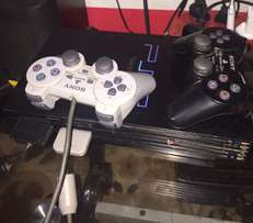 PS2 with two original game pad