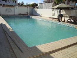 Modern executive 1 bedroom fully furnished holiday apartment with pool