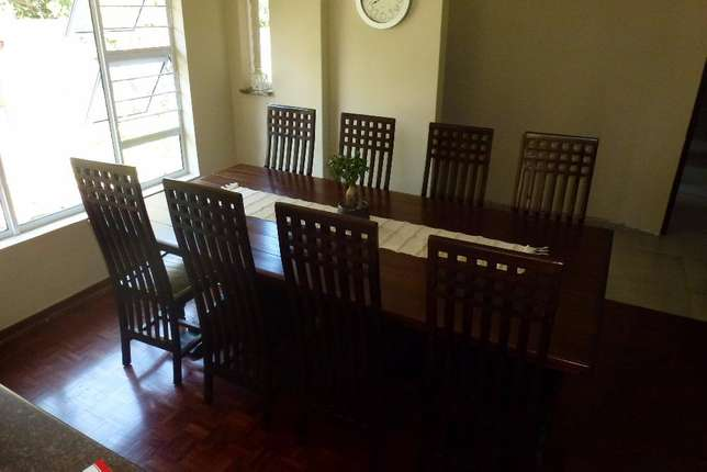 10 seater solid wood dining room table and chairs Parkmore - image 2