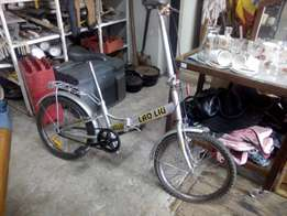 antique fold up bicycle