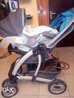 Graco Quattro Tour Reverse Travel System. (Baby Stroller)
