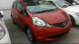 Red Honda Fit New import at a great price