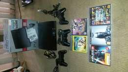 320 GB PS3, 2 Wired Controllers and 5 Games