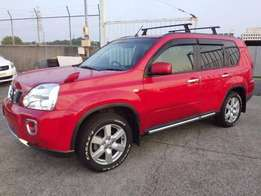 Red Nissan X-Trail 2010