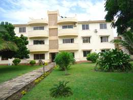 ELEGANTLY built 3 bedroom apartment with pool, mature gardens in nyali