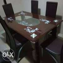 New trendy six seater glass dining table