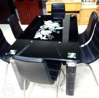 A brand new 6 seater glass dinner table for sale. black.