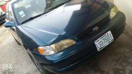 Toyota corolla with factory fitted a/c aka okereju owo e lo very neat