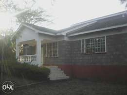 1/4 acre for sale in Ongata Rongai in Nkoroi area with a house on it.