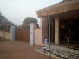 Four bedrooms house plus two stores infront for sale at Adenta