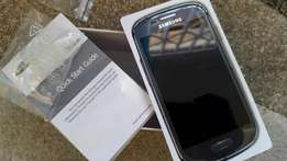 Samsung Galaxy S3 grey and white with cracked screen and a few scratch