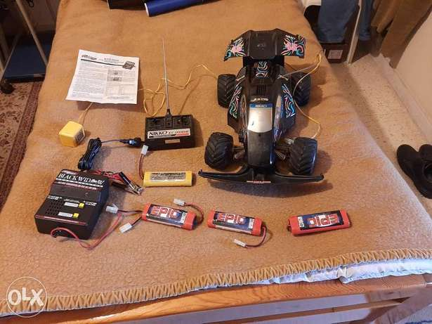 Remote control car with batteries and chargers.