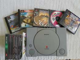 PS1 with 5 games,memory card,controller and plenty of demo discs