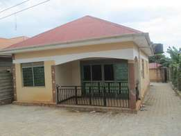 Cheap three bed room stand alone with boys quarter at 1m along Entebe