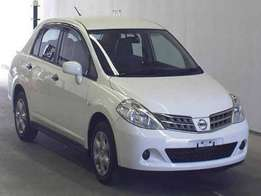 Foreign Used 2010 White Nissan Tiida Saloon Asking Price 890,000/=