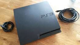 Chipped Playstation 3 slim game system slightly used with games