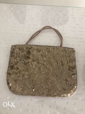 Mademoiselle Zaza indian style golden purse with gold sequins