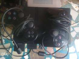 Slim PS2 Console with 2 Original Analog Pad,8 games&all accessories.