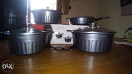 Brand new 7 piece Royalty Line marble cookware set.