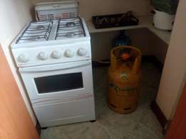Cooker and cylinder