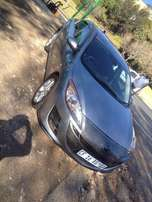 2010 mazda 3 1.6 sedan grey in colour with 131000km leather int R98000