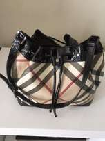 Authentic Burberry Drawstring Bag In Nova Check Patent Leather