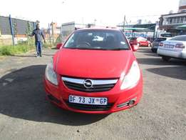 2009 Opel Corsa ,red in color, 4 doors ,52 000km ,excellent condition