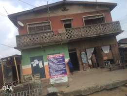 A house for sale at itare road Mushin on a full plot of land