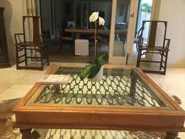 Wooden coffee Table with Glass Top over wrought detail