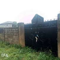 A plot of land fenced with CofO for sale at Oluyole extension Ibadan