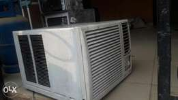 A neat LG gold window unit Air condition