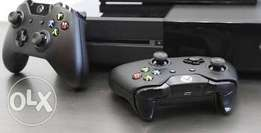XBOX ONE with 2 remotes and charging dock with 1 game.