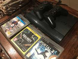 Playstation 3, 2 controllers and 3 games