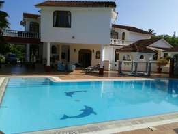 LAVISH 5 bedroom DOUBLE STOREY with pool sitted on1/2ac plot in Nyali