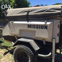 Mission trailer with add on room and full tent cover