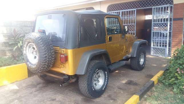 QUICK SALE: Golden Jeep Wrangler Sport Lavington - image 2