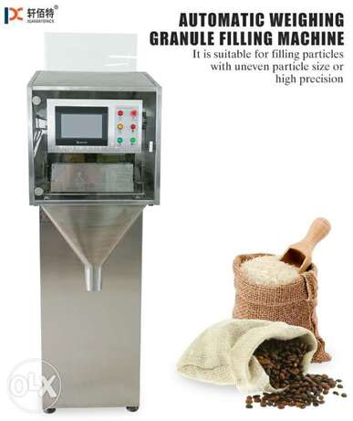 Automatic weighing granule filling machine