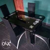 Classy 4-seater glass dining table