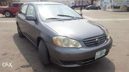 Corolla 2003 very clean hold your money oooo