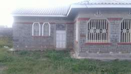 A three bedroom tiled own compound house to let